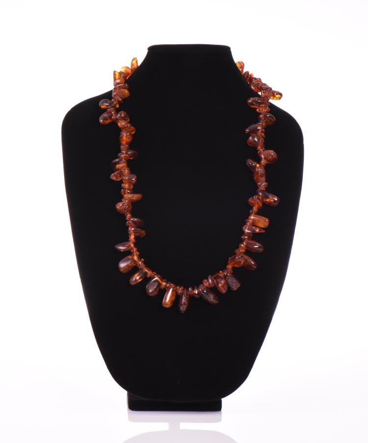 Vintage Polished Amber Necklace.  Estimated mo