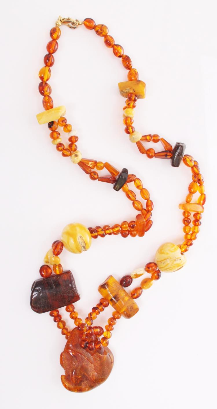 Vintage mixed raw amber necklace. Estimated m
