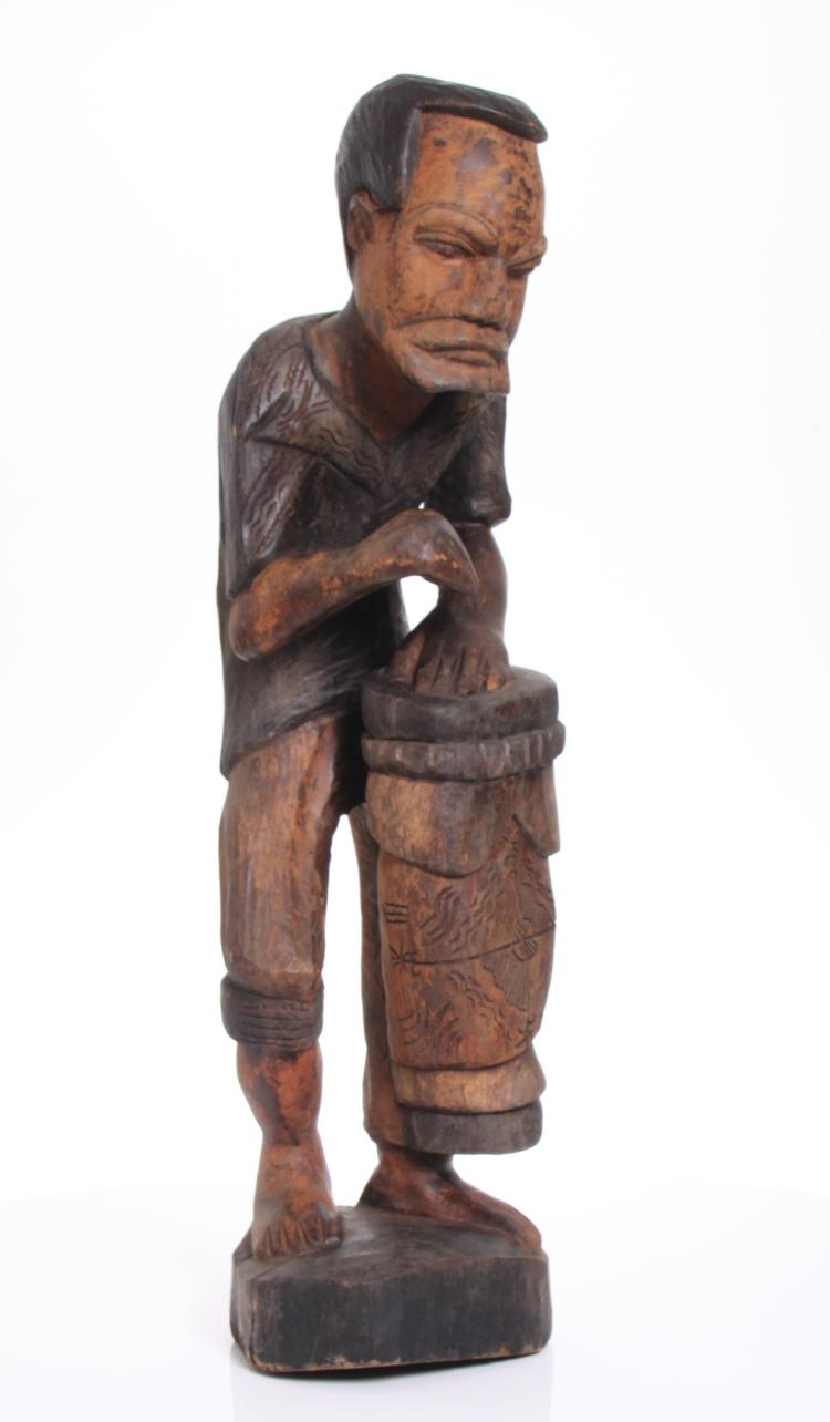 Vintage African carved wood sculpture of a dru
