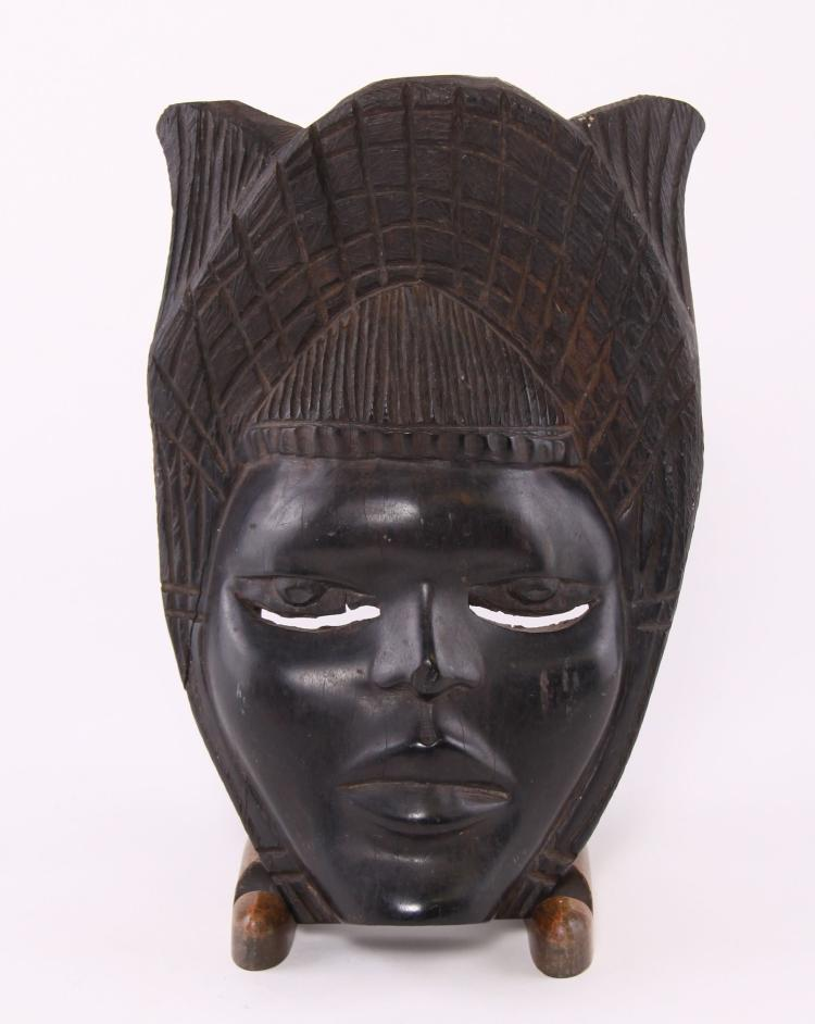 African mask carved from ebony wood.  Estimate