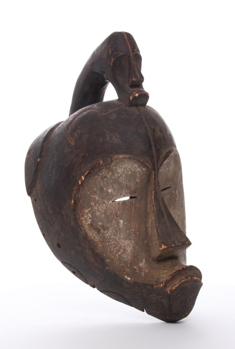 Antique African wood Punu mask, Gabon. Estima