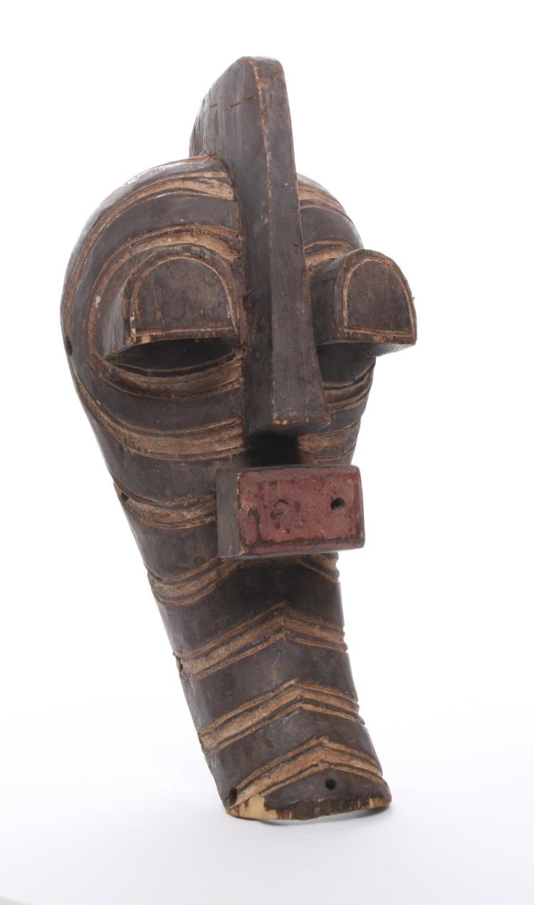 An amazing Kifwebe African wood mask displayin
