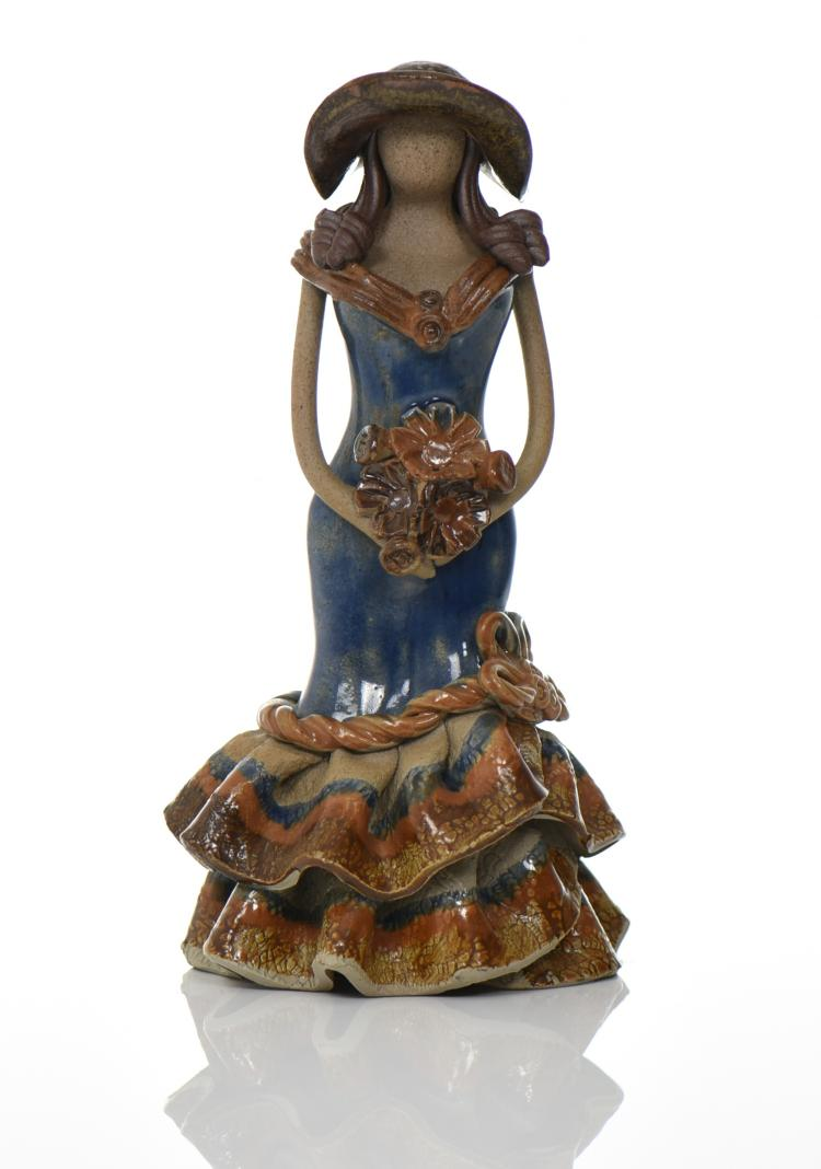 Glazed Ceramic Figure Of A Woman Holding A Bou