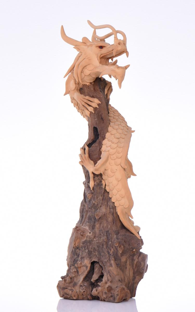 Dragon Sculpture Wrapped Around Driftwood.  Es