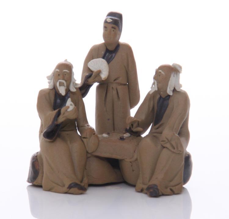 Early 20th Century mud men figurine of three m