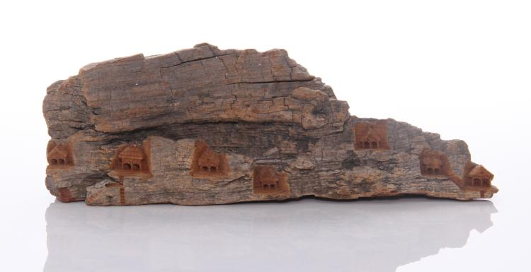 Antique drift wood carving of a small village
