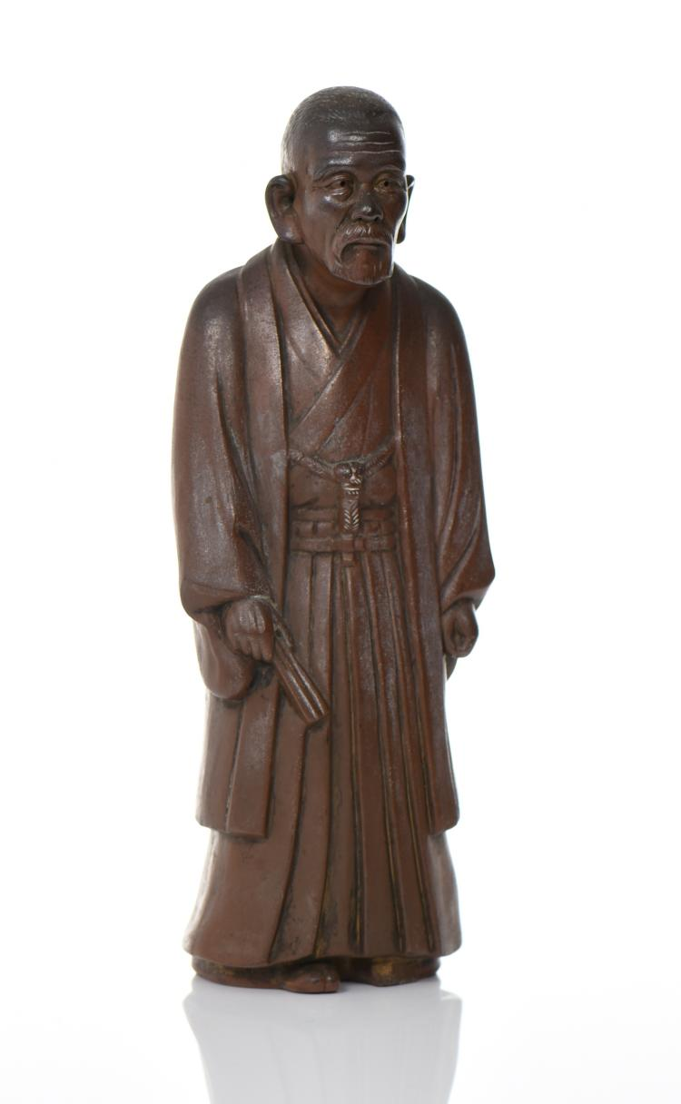 Chinese Brown Glazed Ceramic Figure Of A Robed
