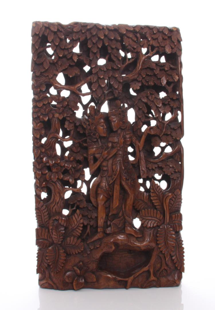 Indonesian pierced relief wood panel carving.