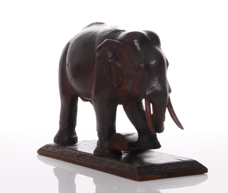 Antique wood carved Elephant lifting a log, In