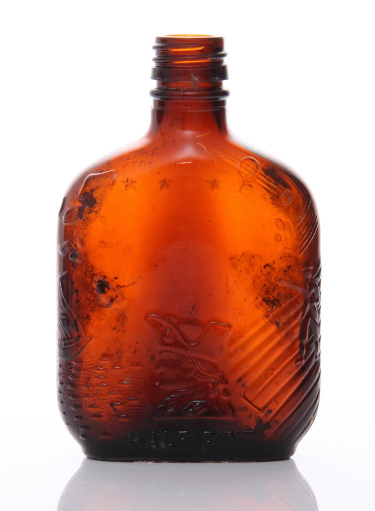 Mid Century brown glass whiskey bottle. The