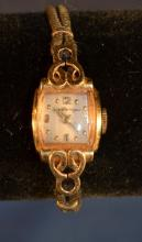 Girard Perregaux & Co. 14kt gold ladies wrist watch with 17 jewels working movement, Gemex gold tone and black cord band