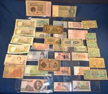 Collection of 36 foreign currency notes from Canada, New Zealand, Bahamas, France, Belgium, Germany, Brazil, Nicaragua, Egypt, Bosna, Myanmar, N & S Korea, etc.