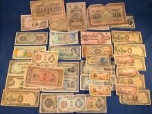 Collection of 42 foreign paper currency notes including Japan, Canada, Bermuda, Mexico, Guatemala, Spain, Russia, Algeria, etc.