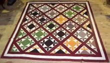 Patchwork quilt, reddish field