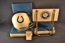 Two vintage Baltimore Colts folding stadium seats and an NFL Pic Nic Flair helmet form carrier
