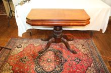 Period carved claw foot game table