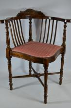 An Edwardian curve and spindle backed corner chair