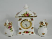 Royal Albert china mantle clock (16cm) in Old Country Roses design with 2 same design ginger jars