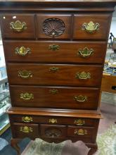 Low bow chest of 4 drawers on table