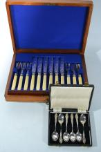 A small canteen of 6 teaspoons and a six place setting canteen of fish knives and forks
