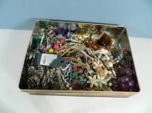 Tin costume jewellery