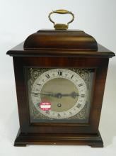 Smiths' 8 day clock in wooden style carriage casing approx 30cm tall