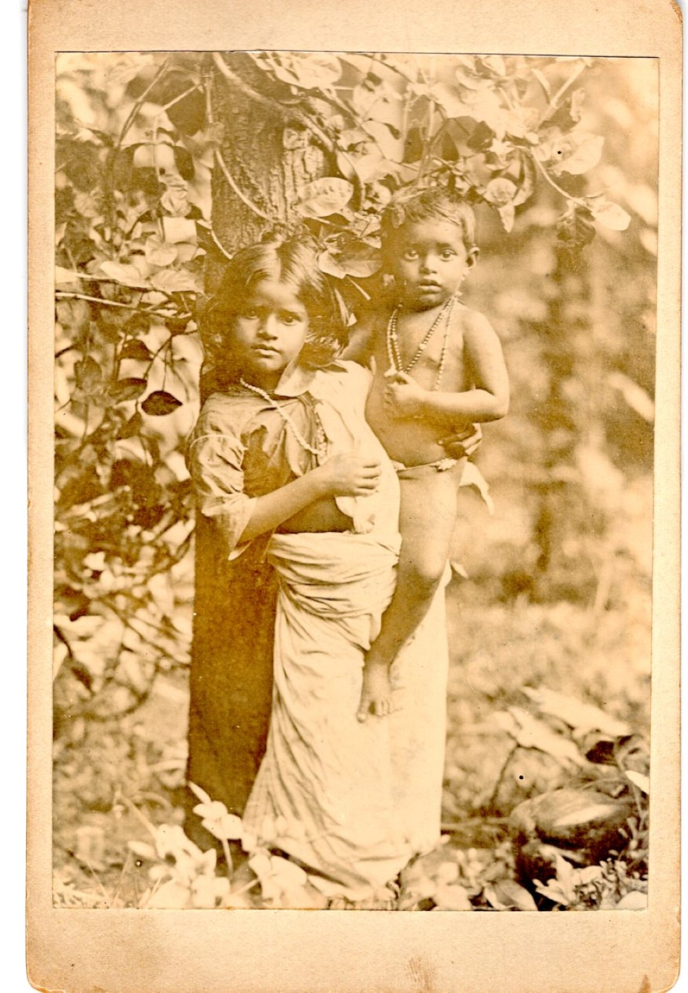 An ethnic girl holding her baby brother