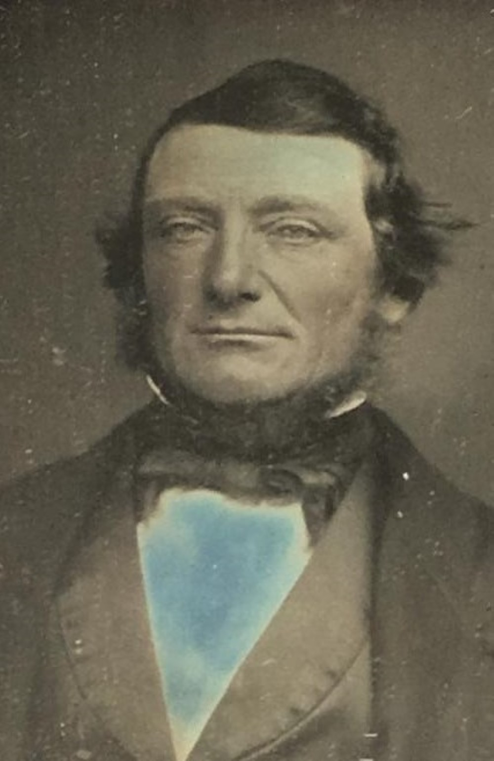 Sixth plate daguerreotype in a half case, tinted blue shirt