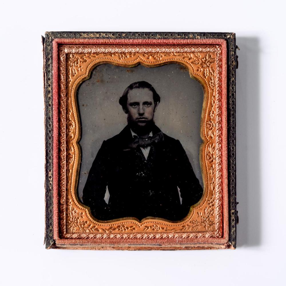 Ambrotype of a young man and large bow tie