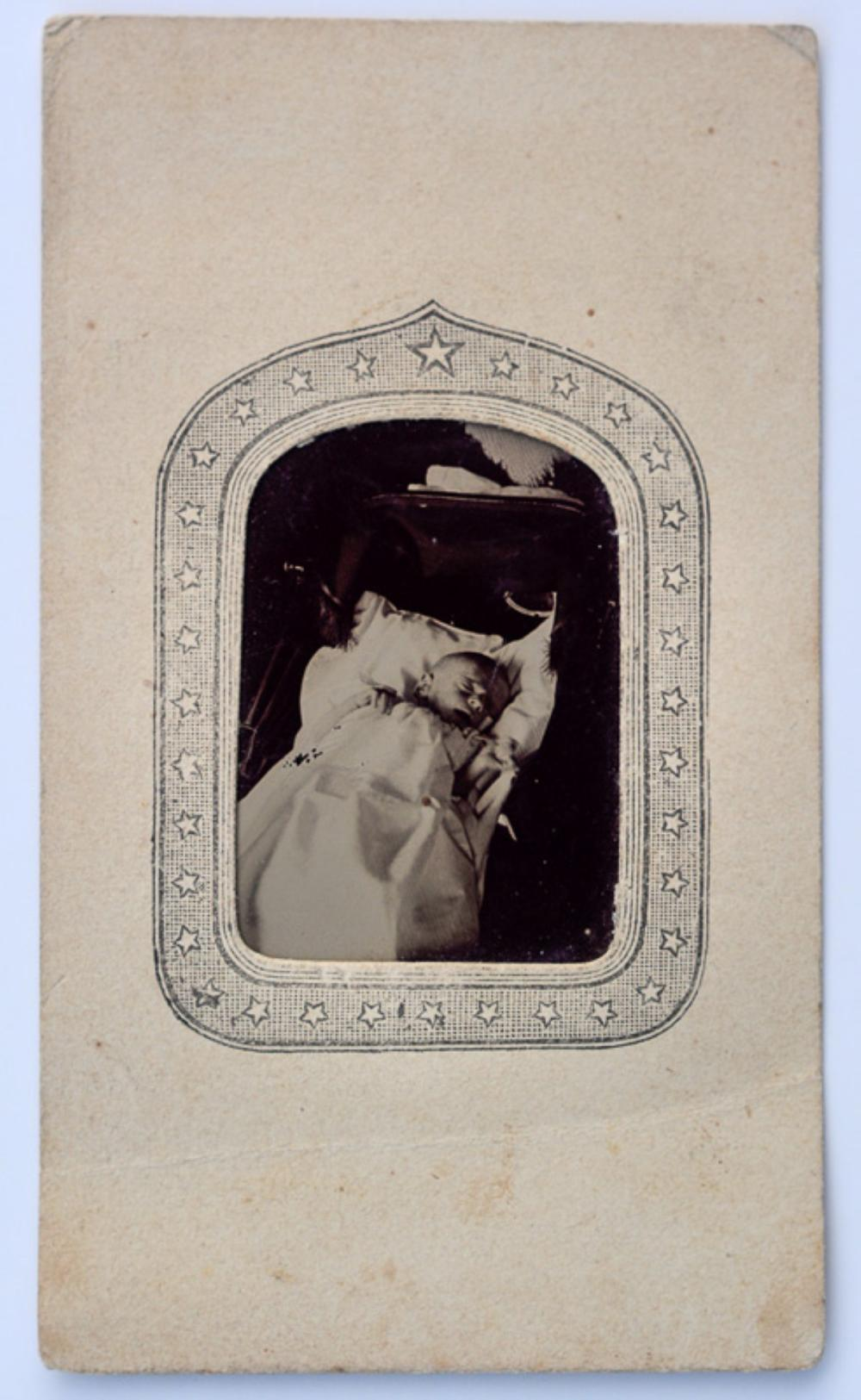 Tintype of a post mortem baby, 1860s.