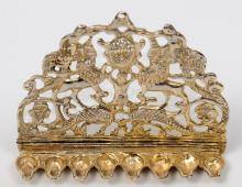 9k gold menorah studded with 14 small diamonds in a wooden box.