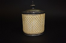 Silver container surrounded with ivory