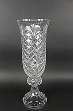 Clear vase with carved patterns.