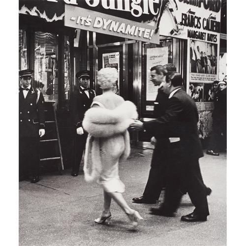WEEGEE (ARTHUR FELLIG) - Marilyn Monroe and Joe DiMaggio, film premiere, New York, 1955