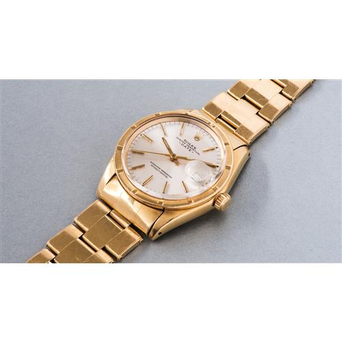 ROLEX - A very fine yellow gold wristwatch with date, center seconds and bracelet, 1967