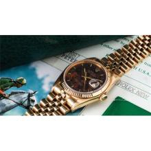 ROLEX - A superb and rare yellow gold wristwatch with wood dial, date, bracelet, presentation box, guarantee and hangtags, 1985