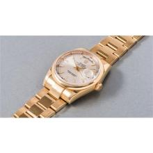 ROLEX - A fine and highly attractive yellow gold wristwatch with silver-colored dial and bracelet, 2003