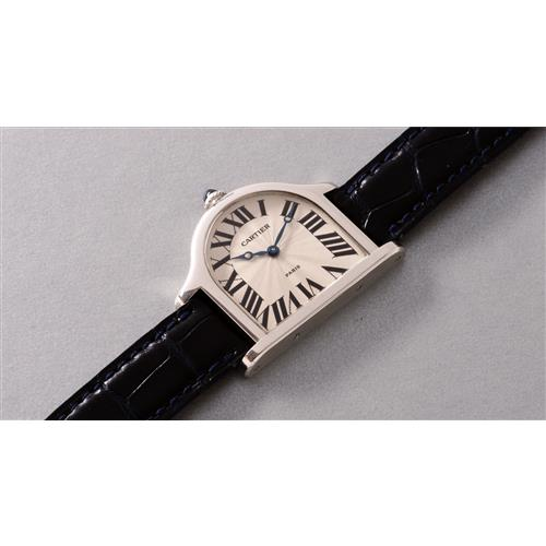 CARTIER - A highly attractive and unique platinum asymmetrical wristwatch, accompanied by Cartier guarantee, 1996