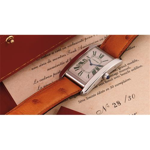 CARTIER - A fine and attractive large rectangular limited edition platinum wristwatch with dark green Roman numerals, 2008