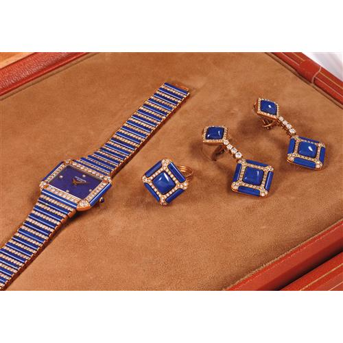 PATEK PHILIPPE - A lady's extremely exclusive yellow gold, lapis lazuli and diamond-set wristwatch with matching ring, earrings and box, 1977