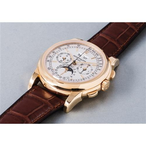 PATEK PHILIPPE - A very rare and highly attractive yellow gold perpetual calendar chronograph wristwatch with moon phases, accompanied by presentation box, Certificate of Origin, additional caseback and pin pusher, 2008