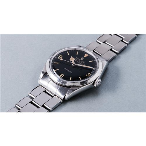 ROLEX - A fine and attractive stainless steel wristwatch with black glossy dial and bracelet, 1965