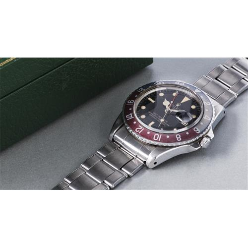ROLEX - A very rare and attractive stainless steel dual time zone wristwatch with black lacquer dial, pointed crown guards, faded