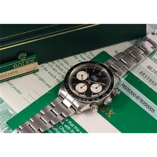 ROLEX - A very rare and highly attractive stainless steel chronograph wristwatch with black dial and bracelet, accompanied by presentation box, guarantee, and certificate from Beyer in Zürich, 1986