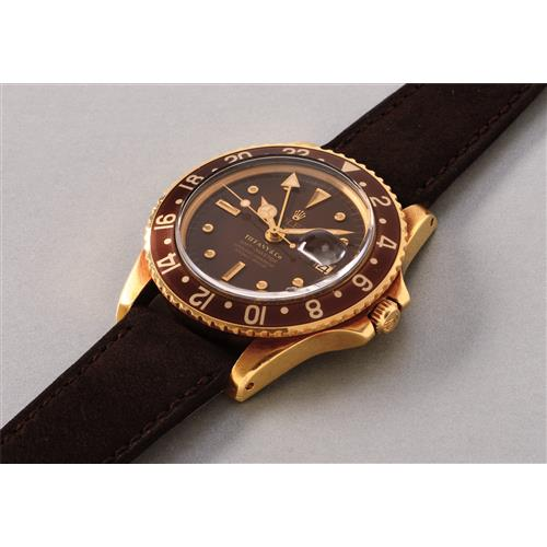 ROLEX - A very rare and highly attractive yellow gold dual time wristwatch, retailed by Tiffany & Co., 1969