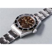 "ROLEX - An extremely rare and highly attractive stainless steel wristwatch with centre seconds, tropical brown ""four liner"" dial and bracelet, 1959"