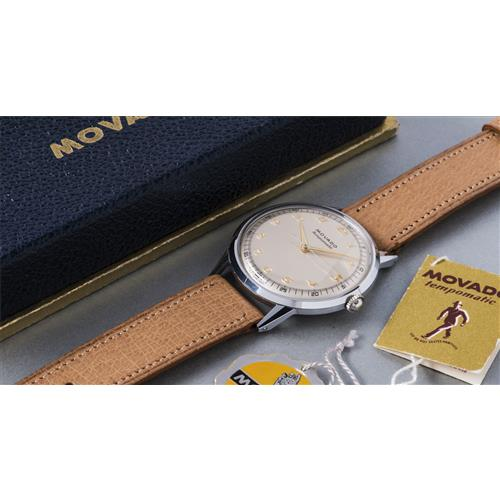 MOVADO - A large and attractive stainless steel wristwatch with gold Breguet numerals, original box and hang tags, circa 1950