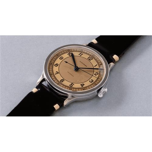 MOVADO - A very rare, oversized and  attractive stainless steel wristwatch with three tone dial and center seconds, Circa 1938
