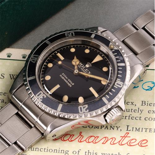 ROLEX - A highly attractive and rare stainless steel wristwatch with pointed crown guards, gilt