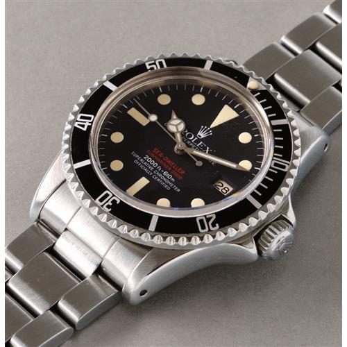 ROLEX - A fine and attractive stainless steel diver's wristwatch with date, bracelet, and gas escape valve, 1977
